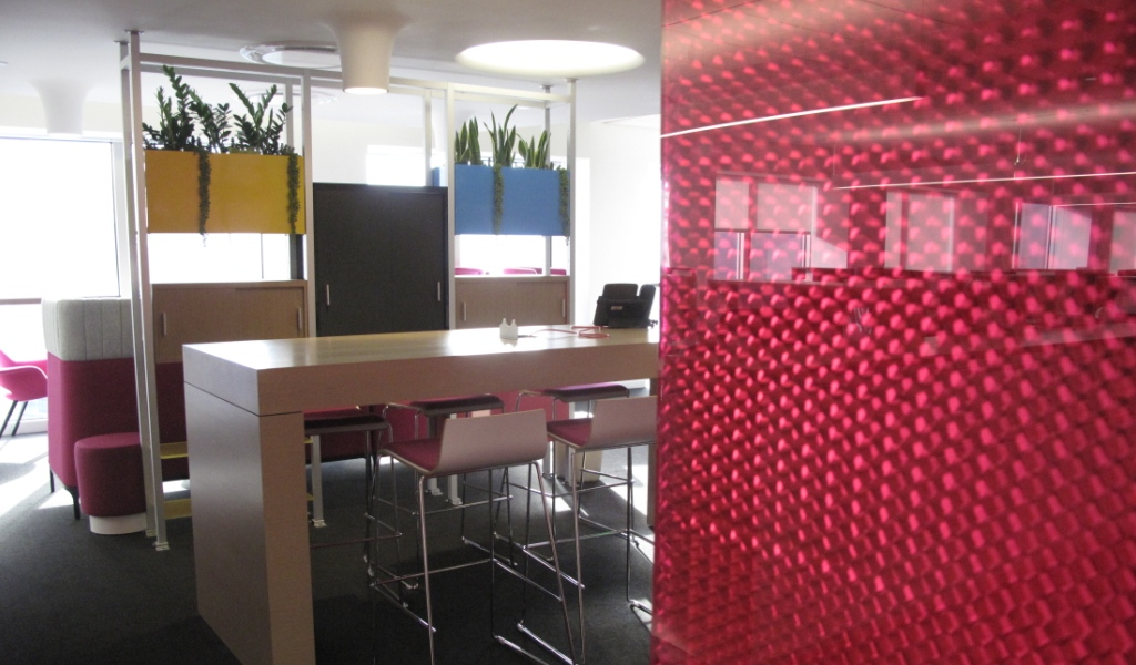 Break out room partitions synchronising with vibrant CMYK-based color palette of architect Woods Bagot